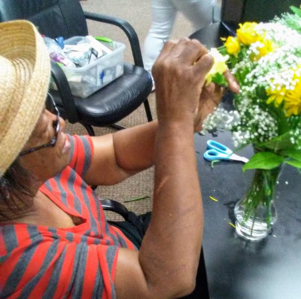 A client learns flower arranging.
