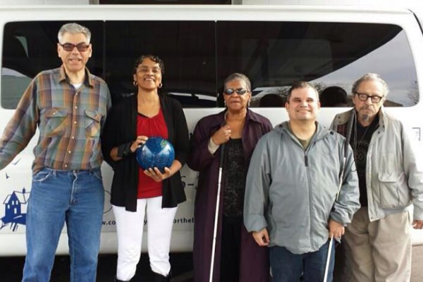 Photo of group returning from bowling trip.